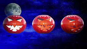 Abstract pumpkin heads on dark blue sky stock video footage