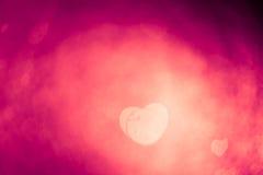 Abstract purple bokeh heart shape stock photography