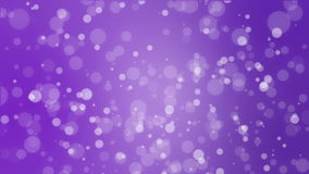 Abstract purple holiday background with animated bokeh lights. Glowing abstract holiday background with white bokeh lights flickering on purple gradient backdrop stock footage