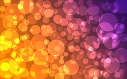 Abstract purple and orange Bokeh circles for Christmas. Background, glitter light Defocused and Blurred Bokeh Royalty Free Stock Photography