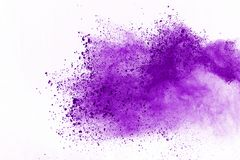 Abstract purple powder explosion on white background. abstract colored powder splatted, Freeze motion of colorful powder exploding.  royalty free stock photo