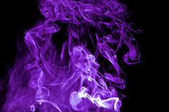 Abstract Purple Smoke On Black Background. Stock Image