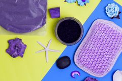Abstract purple Spa items on colorful blue and yellow background, top view stock images