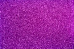 Abstract purple sparks background. Purple background with sparkles Stock Image
