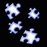 Abstract puzzle pieces. Abstract blue puzzle pieces on black background Stock Photo