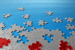 Abstract puzzles in water concept Royalty Free Stock Photography