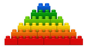 Abstract pyramid from plastic building blocks. 3d render of abstract pyramid from plastic building blocks isolated over white background Stock Photography