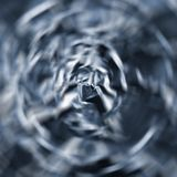 Abstract radial zoom tunnel of crumpled silver aluminum foil closeup background texture pattern in blue Stock Photography