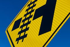 Abstract Railroad crossing sign at angle. With blue sky vector illustration