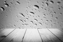 Abstract rain drops on a window or water drops on grass and wood Royalty Free Stock Photos