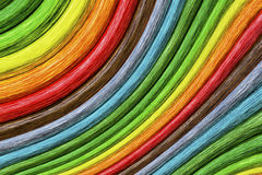 Abstract Rainbow Curvy Sticks Background. Abstract art rainbow sinuous or curvy wooden sticks colorful background royalty free stock photography