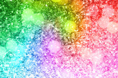 Abstract rainbow gold glitter background Stock Photography