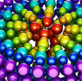 Abstract, rainbow-like group of shiny spheres Royalty Free Stock Images