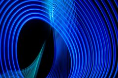Abstract Rainbow Neon Glowing Crossing Lines Pattern Stock Photo