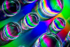 Abstract Rainbow Coloured Water Drops. With a prism colour effect royalty free stock photo