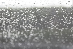 Abstract raindrop and bokeh on windshield, blur Stock Photo