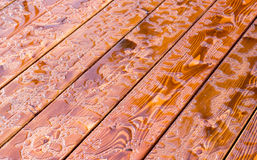 Abstract raindrops pattern on wooden board. Background stock images