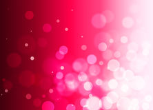 Abstract raspberry red background with bokeh effect, gradient,. Festive red bokeh background with free space Royalty Free Stock Images