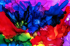 Abstract raster multicolored splashes. Colorful background hand drawn with bright inks and watercolor paints. Color splashes and splatters create uneven Royalty Free Stock Photos
