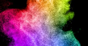 Abstract real multicolor powder explosion on black background, slow