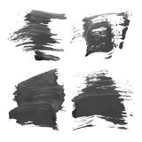 Abstract realistic smears black ink on white paper Royalty Free Stock Photos