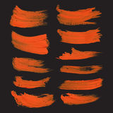 Abstract realistic strokes drawn thick orange paint on black Stock Photos