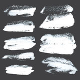Abstract realistic strokes drawn thick white paint on black Stock Photo