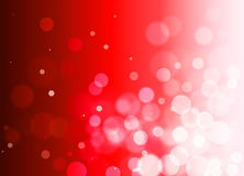 Abstract red background with bokeh effect, gradient, circles. Festive red bokeh background with free space Royalty Free Stock Photos