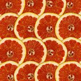 Abstract red background with citrus-fruit of grapefruit Stock Photos