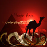 Abstract red background. Desert, pyramid, camel, red night. Magic Asia. Royalty Free Stock Image