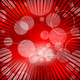 Abstract red background design with bursting rays Royalty Free Stock Image