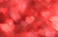 Abstract red background with heart-shaped boke. Abstract red valentine background with heart-shaped boke effect Stock Photo