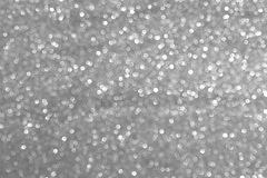Sparkly glitter, silver grey background bokeh effect. Abstract and red background, with silver grey, glitter and bokeh effect. Luxury color. Little bokeh stock photos