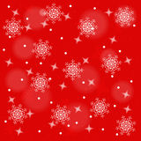 Abstract red background with snowflakes. Royalty Free Stock Photography