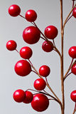 Abstract red berries. Red berries on fake flowers form abstract pattern Stock Image