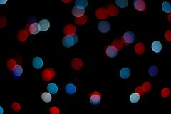 Abstract red and blue bokeh texture on black background. royalty free stock photo