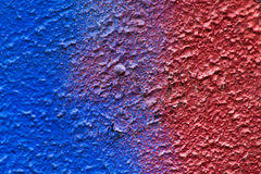 Abstract red and blue paint on plaster. Royalty Free Stock Image