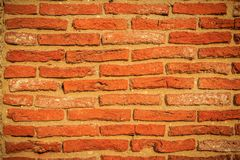 Abstract red brick old wall texture background. Ruins uneven cru. Mbling red brick wall background texture Royalty Free Stock Photo