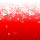 Abstract red christmas background. With snowflakes Royalty Free Stock Photos