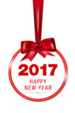 Abstract red christmas ball on ribbon - new year 2017. Abstract hanging red Christmas ball on red ribbon and Happy New Year 2017 wish -  on white background Stock Photography