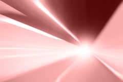 Abstract red color motion blue background. Tunnel red and pink color lights acceleration speed motion blur with light flare effect. Motion blur visualizies the royalty free stock photography