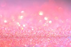 Abstract pink coral glitter light bokeh holiday party background. Abstract red coral glitter light bokeh holidayand festive party background royalty free stock photography
