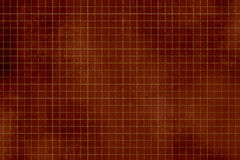Dark red background - grunge design - checked pattern. Abstract red grunge background in vintage style with gold checkered texture Royalty Free Stock Image