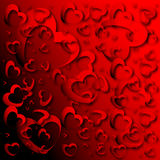 Abstract red heart background. Abstract background of bright red, three-dimensional hearts suitable for a Valentine's theme Royalty Free Stock Image