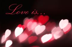 Postcard background hearts bokeh effect Love is Royalty Free Stock Images