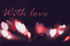 Abstract red heart bokeh vision bright fantasy on black background design in red frame with red heart, illuminated light effect. Royalty Free Stock Photos