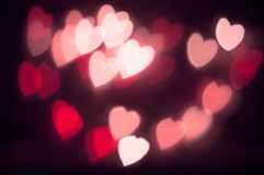 Abstract red heart bokeh vision bright fantasy on black background design in red frame with red heart, illuminated light effect. Stock Photo