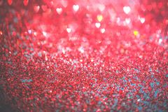 Abstract red heart glitter light bokeh holiday party background. Abstract red heart glitter light bokeh holidayand festive party background. Love sentiment and royalty free stock photo