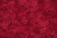 Abstract red hearts bokeh background royalty free stock image