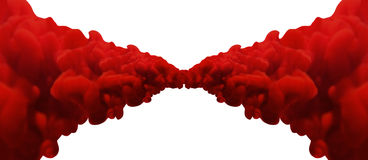 Abstract Red Merging Inks. An abstract view if two merging symmetrical jets of thick red bulbous ink on a white background Royalty Free Stock Images